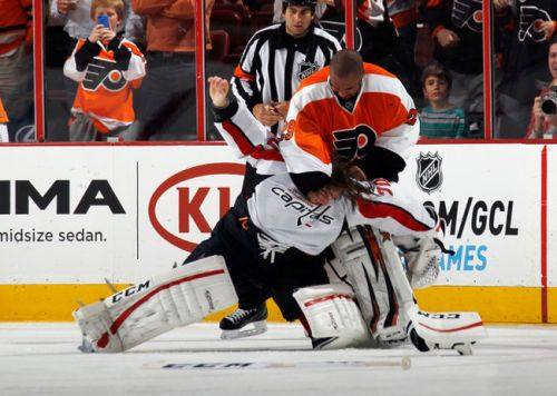 Ray Emry beats down a hapless Holtby.